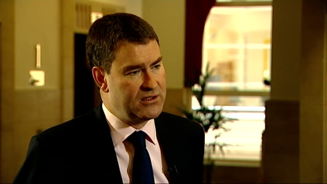 parties trade claims over beneficiaries of latest tax cuts; int david gauke mp interview sot - 24 million people are going to benefit from a tax cut - beneficiary stock videos & royalty-free footage