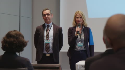 partners discussing with audience during seminar - public speaker stock videos & royalty-free footage