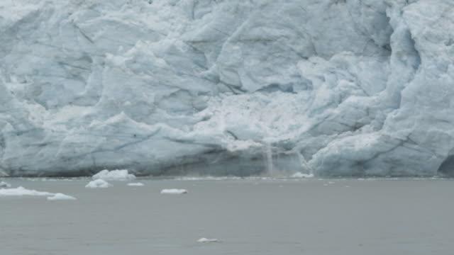 Parts break off glacier and fall into water, Alaska, 2011