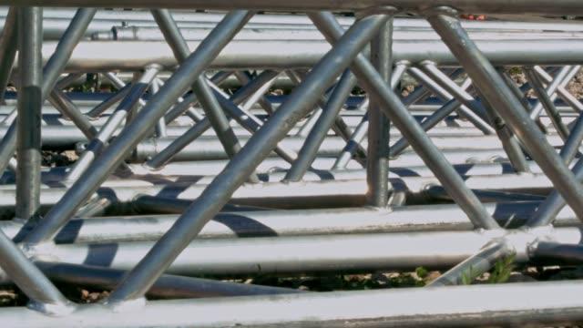 Parts of Alluminium truss lying on the ground