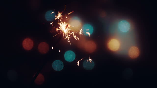 party feeling with sparklers - sparkler stock videos & royalty-free footage