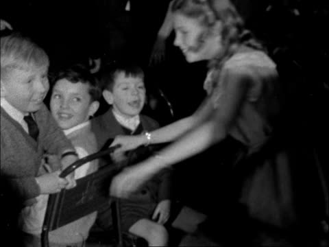 party for dockers' children; england: london - australia house children playing musical chairs: children sit down - girl runs round looking for... - manual worker stock videos & royalty-free footage