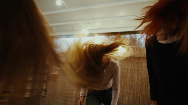 party friends go wild and dance hard - head banging stock videos & royalty-free footage
