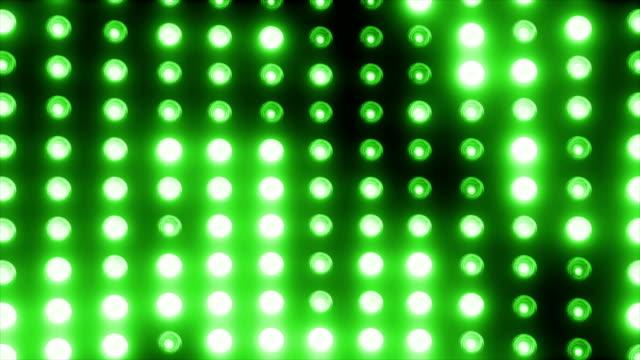 vidéos et rushes de mur vert de lumière de de partie pour la scène loopable - ampoule