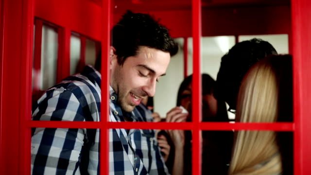 party in die telephone booth - telefonzelle stock-videos und b-roll-filmmaterial