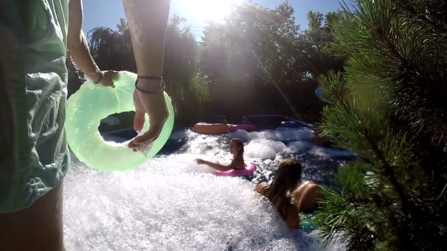 party outdoor summer young adults pool foam bubble - real life stock videos & royalty-free footage