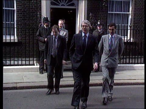 Party Politics ITN LIB London CMS Robin Cook MP at mikes announcing Labour's health policy No 10 Downing Street MS PM John Major along towards to...
