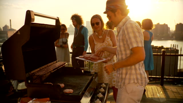 ms party scene, man preparing barbecue / brooklyn, new york - summer stock videos & royalty-free footage