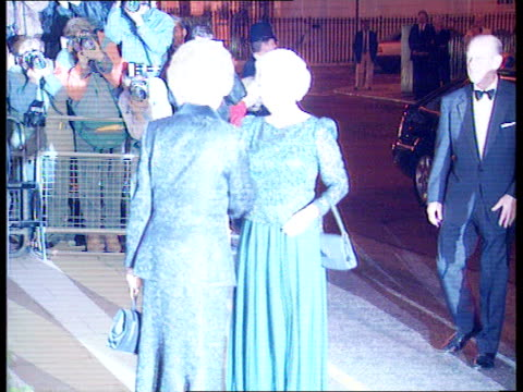 party to celebrate thatcher's 70th birthday itn ms queen elizabeth ii greeted by curtseying margaret thatcher bowing denis and then philip similarly... - inchinarsi video stock e b–roll