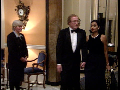 party to celebrate thatcher's 70th birthday; sky pool int mark thatcher posing with wife diane michael caine along with wife shakira r-l lms... - 俳優 マイケル・ケイン点の映像素材/bロール