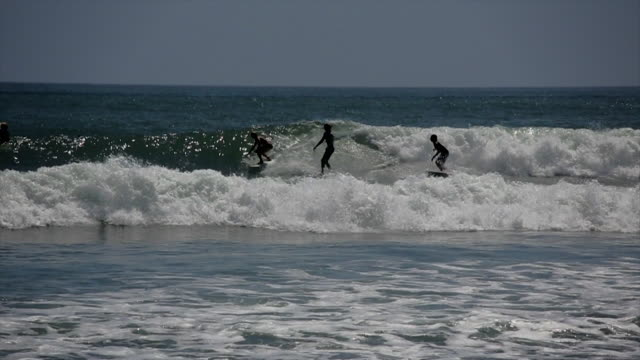 party wave surfing topanga - malibu stock videos and b-roll footage