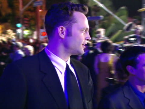 Vince Vaughn walking into party saying hello to reporter