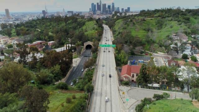 pasadena freeway and downtown los angeles - aerial shot - pasadena los angeles video stock e b–roll