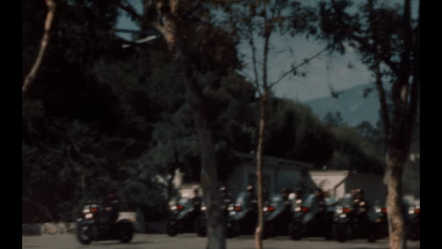 pasadena police motorcycle training around the rose bowl parking lot area in the late 1940's - pasadena los angeles video stock e b–roll