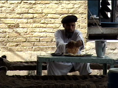 MS Pashtun man having lunch in roadside restaurant Darrah in Swat Agency of Tribal Zones Federally Administered Tribal Areas Pakistan AUDIO