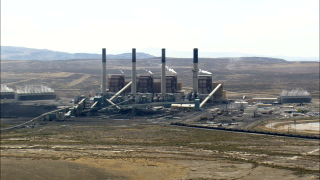 pass a coal fired power station  - aerial view - wyoming, sweetwater county, united states - wyoming stock videos & royalty-free footage