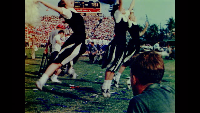 1958 pass dropped in end zone at the orange bowl - cheerleader stock videos and b-roll footage