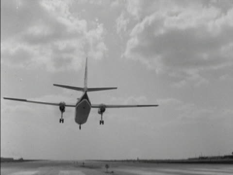 A passenger aircraft flies over the camera as it comes into land at London Airport 1965