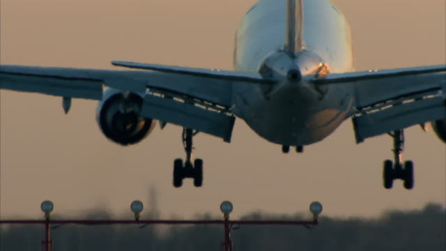 passenger aircraft landing - landing touching down stock videos & royalty-free footage