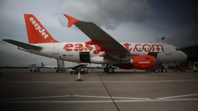 a passenger aircraft operated by easyjet plc sits during refuelling at stansted airport operated by manchester airports group in stansted uk on... - 給油点の映像素材/bロール