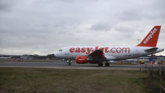 passenger aircraft, operated by norwegian air shuttle asa, passes passenger aircraft operated by easyjet plc in crawley, u.k. on tuesday, jan. 10... - plc stock videos & royalty-free footage