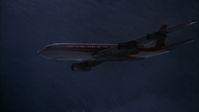 a passenger airliner flies through a thunder storm. - thunderstorm stock videos & royalty-free footage