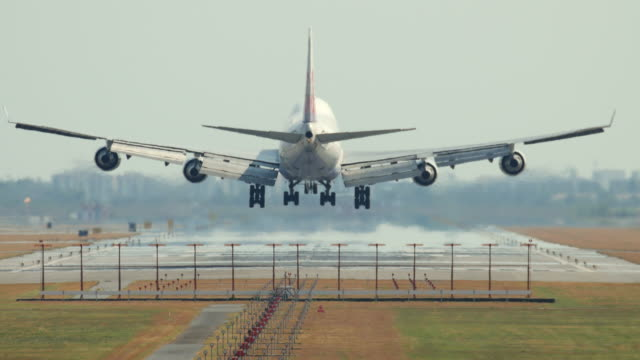 passenger airplane landing, 4k(uhd) - landing touching down stock videos & royalty-free footage