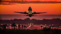 Passenger airplane taking off at sunset