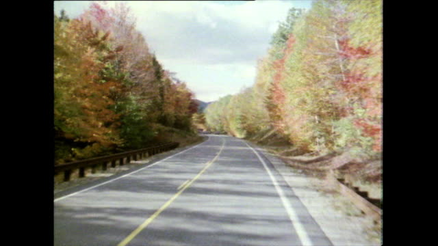 passenger pov along new hampshire road in autumn; 1981 - appalachian mountains stock videos & royalty-free footage