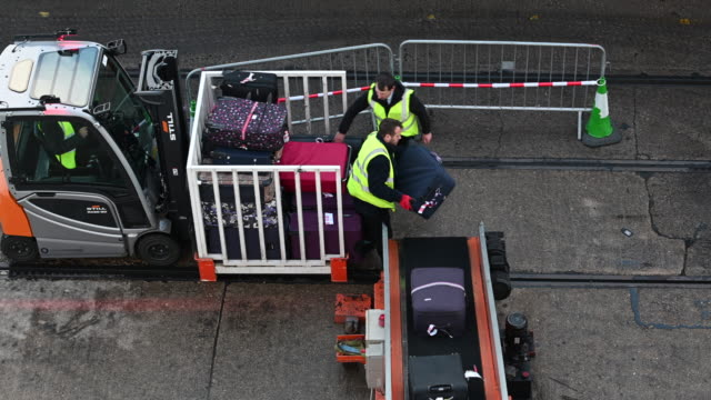 passenger bags are loaded onto a cruise ship on a conveyor belt by baggage handlers at the port of southampton on february 10 2019 in southampton... - southampton england stock videos and b-roll footage