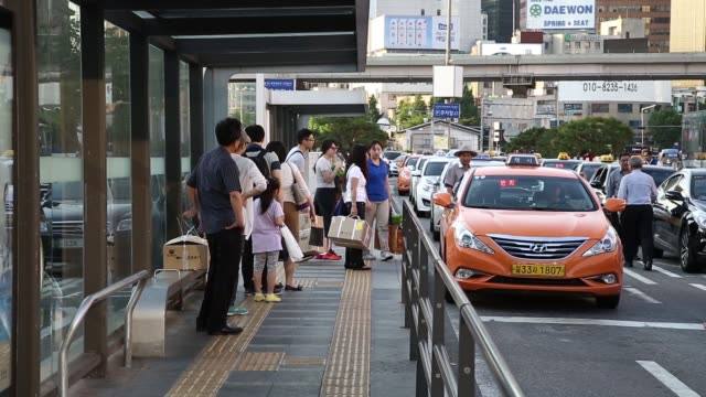 ws a passenger boards a taxi at a taxi stand ws passengers walk to a taxi stand ws a taxi leaves a taxi stand as passengers queue at the taxi stand... - taxi stand stock videos and b-roll footage