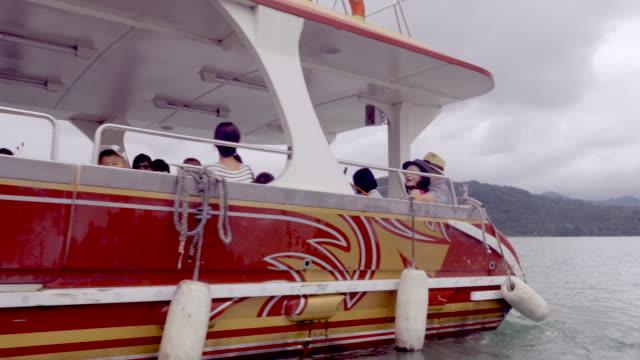passenger boat in sun moon lake, taiwan - sun moon lake stock videos and b-roll footage
