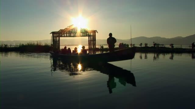 passenger boat moving in inle lake, myanmar - 門点の映像素材/bロール
