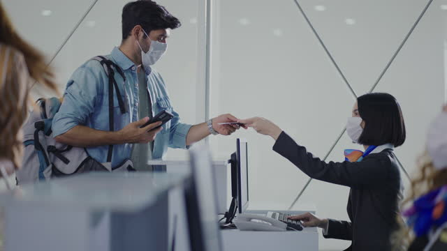passenger check in at counter in international airport - airport check in counter stock videos & royalty-free footage