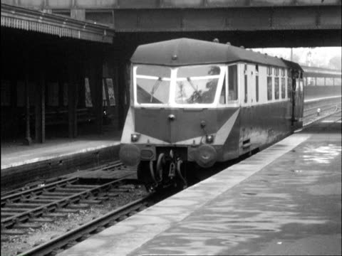 ms passenger coaches pulling into station and station workers load packages onto train / various including tenbury wells and bewdley, worcestershire, england - tenbury wells stock videos and b-roll footage