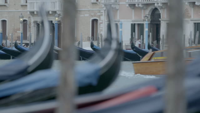 WS Passenger craft moving in canal, gondolas moored at Grand Canal / Venice, Italy