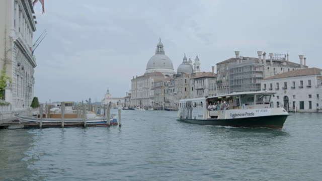 WS Passenger craft moving in canal, Santa Maria della Salute church in background / Venice, Italy
