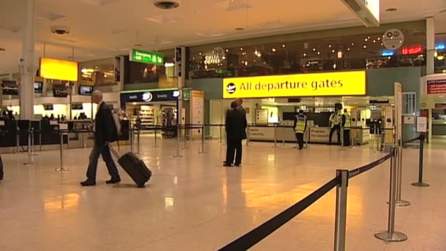 passenger drags his luggage across floor at an empty heathrow airport following closure of uk airspace due to large volcanic irruption in iceland... - flugpassagier stock-videos und b-roll-filmmaterial