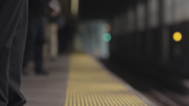 cu passenger feet wait for train - new york city subway stock videos & royalty-free footage