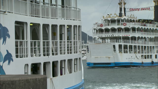 a passenger ferry comes into dock at kagoshima bay.  - ferry stock videos & royalty-free footage