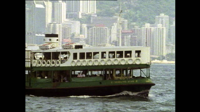 passenger ferry crosses hong kong harbour; 1989 - star ferry stock videos & royalty-free footage
