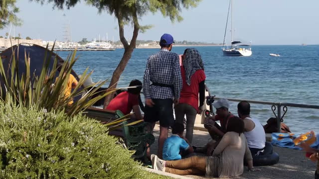 a passenger ferry has docked in kos ready to begin processing thousands of syrian refugees more than seven thousand migrants are understood to be on... - 2015 stock-videos und b-roll-filmmaterial