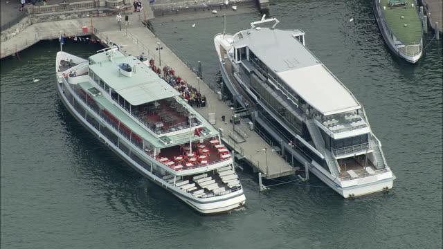 AERIAL ZO Passenger ferry in dock and cityscape, Zurich, Switzerland