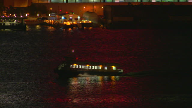 Passenger Ferry Traveling Up the Hudson River at Night