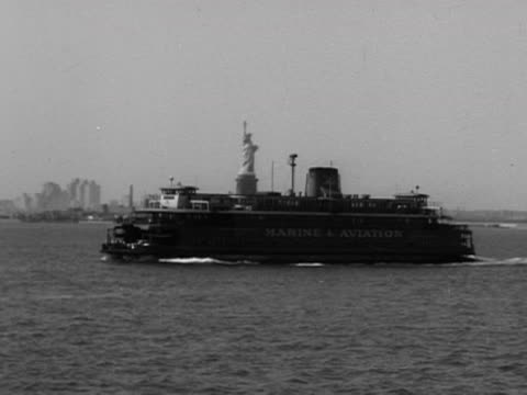 passenger ferry travels past the statue of liberty. 1957. - ferry stock videos & royalty-free footage