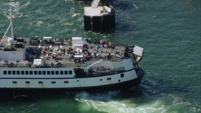 aerial passenger ferry, with passengers on deck, approaching the dock / oak bluffs, massachusetts, united states - ferry stock videos and b-roll footage
