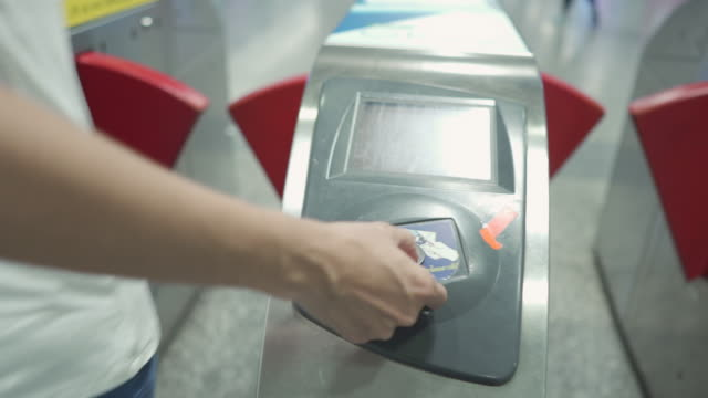 passenger goes through ticket barrier in subway. - ticket stock videos & royalty-free footage