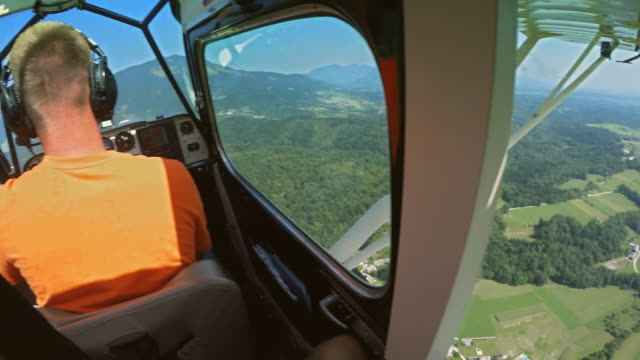 pov passenger in a light aircraft enjoying the beautiful view on a sunny day - pilot stock videos & royalty-free footage