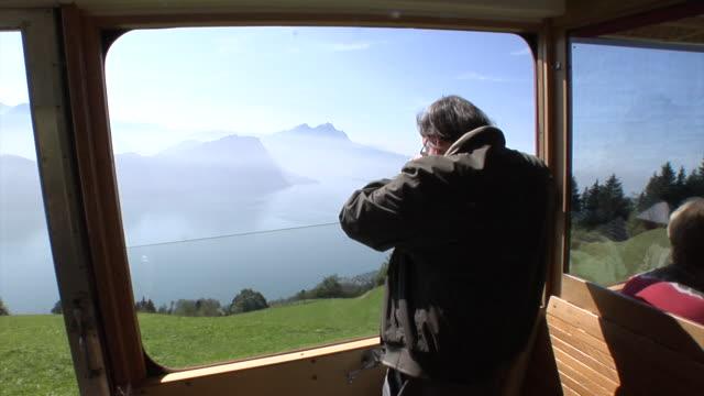 passenger in a vitznau rigi train - lake lucerne stock videos & royalty-free footage