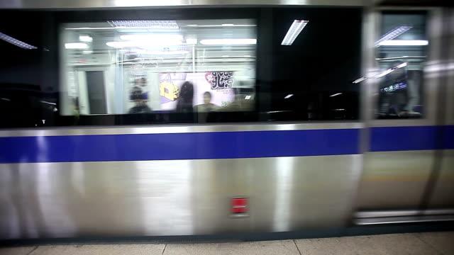 beijing, china - october 24, 2016: passenger in the subway in beijing city. - 銀点の映像素材/bロール